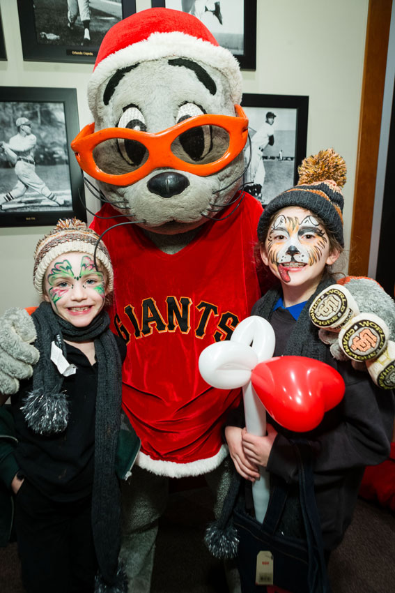 Lou Seal attends Holiday Heroes
